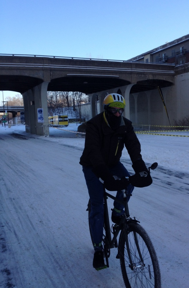 Tony Desnick rides down the Midtown Greenway in Minneapolis, a rails-to-trails bikeway that forms a popular east-west route.