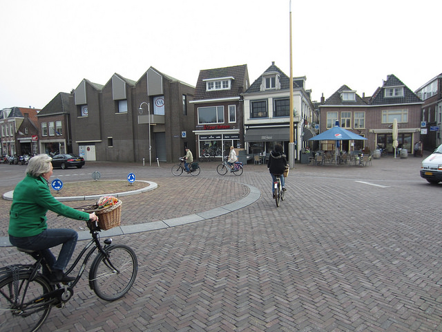 Cyclists and cars mingle in a Shared Space